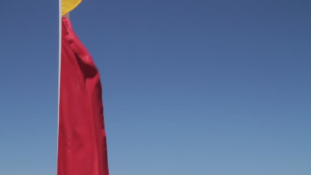 ms td shot of lifeguard flags at beach / melbourne, victoria, australia - bagnino video stock e b–roll