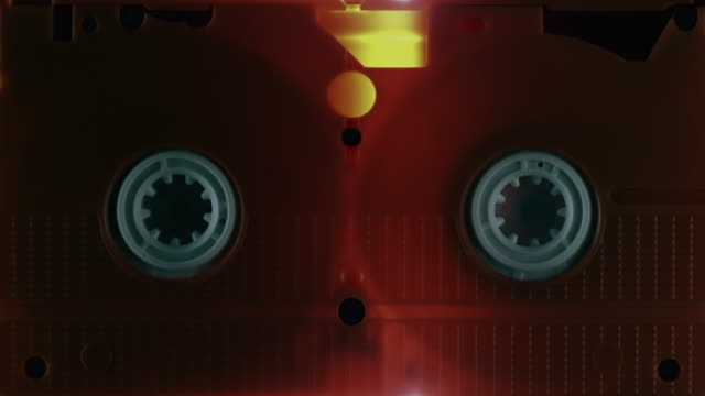 cu shot of light from scanner moving across vhs tape / london, united kingdom  - audio equipment stock videos & royalty-free footage