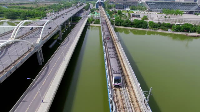 aerial shot of light rail and car driving/xi'an,china - railings stock videos & royalty-free footage