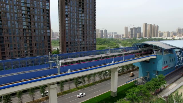 AERIAL shot of Light rail and car driving/Xi'an,China