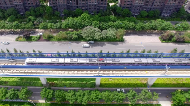 AERIAL shot of Light rail and car driving/Xi'an,China