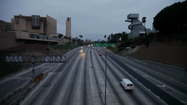 MS Shot of Light traffic moving on freeway and Los Angeles Catholic Church visible / Los Angeles, California, United States