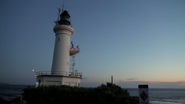 ms shot of lighthouse at dusk / point lonsdale, victoria, australia  - lighthouse stock videos & royalty-free footage
