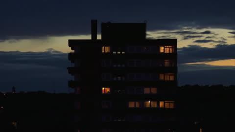 ms t/l shot of lights in windows of block of flats at night / london, united kingdom  - lägenhet bildbanksvideor och videomaterial från bakom kulisserna