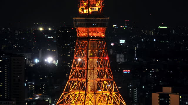 stockvideo's en b-roll-footage met ms t/l shot of lights turning off at tokyo tower at night / tokyo, japan - nationaal monument beroemde plaats