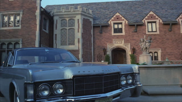 MS Shot of lincoln car parked in front of brick house