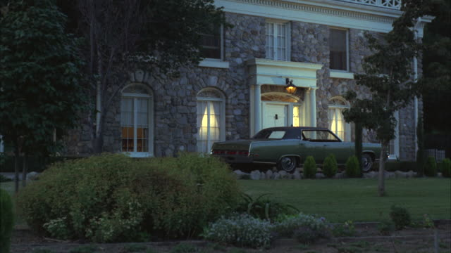 MS Shot of lincoln car standing in front of Stone house