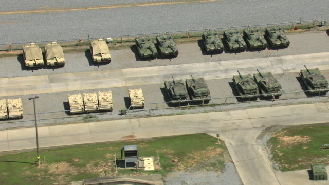 MS AERIAL ZI Shot of lines of tanks at military Camp Shelby in broad day light / Mississippi, United States