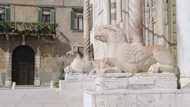 MS Shot of Lion Sculpture in front of Cathedral Santa Maria Matricolare / Verona, Veneto, Italy