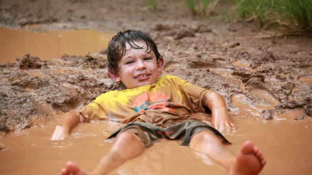 ms shot of little boy taking mud bath / montezuma, punteranes, costa rica - mud stock videos & royalty-free footage