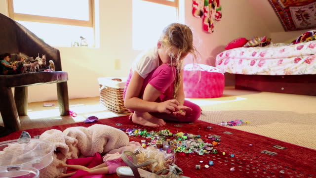 ms shot of little girl playing with her bead collection in her room / lamy, new mexico, united states - one girl only stock videos & royalty-free footage