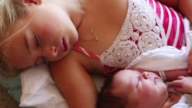 cu tu td shot of little girl sleeping with her newborn brother / lamy, new mexico, united states - brother stock videos & royalty-free footage