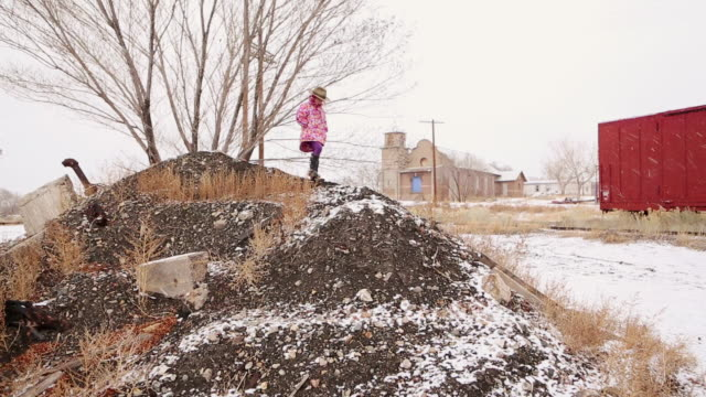ms shot of little girl walking down hill in snow / lamy, new mexico, united states - lamy new mexico stock videos & royalty-free footage