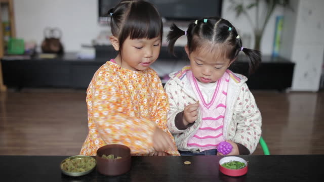 MS Shot of Little girls playing game in home / Xi'an, Shaanxi, China