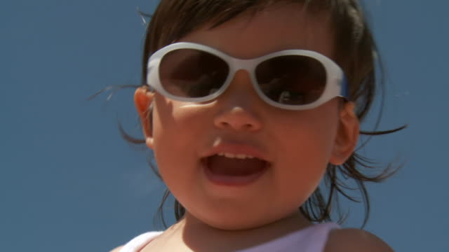 CU LA Shot of little metis girl with sunglasses / Marbella, Andalusia, Spain