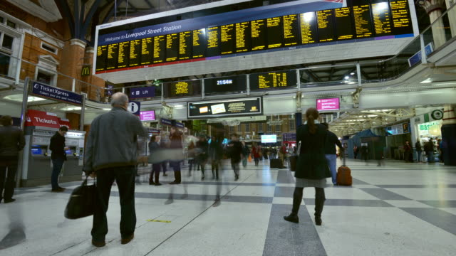 ms t/l shot of liverpool street station, interior night time destination boards with commuters moving / london, greater london, united kingdom - greater london stock videos & royalty-free footage