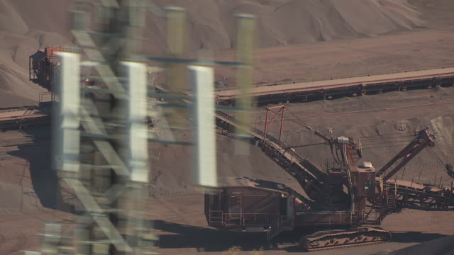 CU AERIAL Shot of loaders at ore collection site / Minnesota, United States