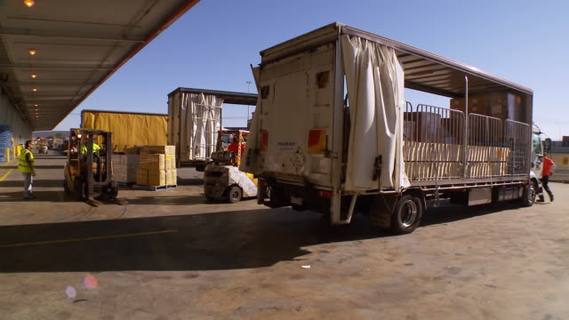 ms t/l shot of loading and unloading area / melbourne, victoria, australia - image stock videos & royalty-free footage