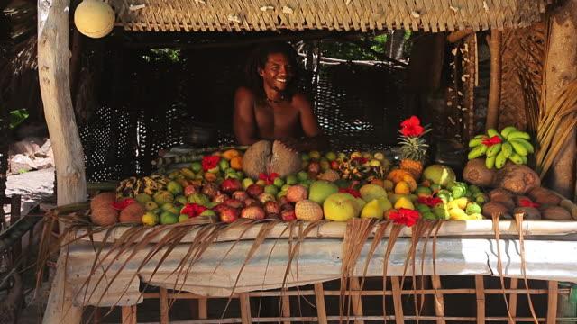 ms pan shot of local fruits seller smiling / praslin, seychelles - seychelles stock videos & royalty-free footage