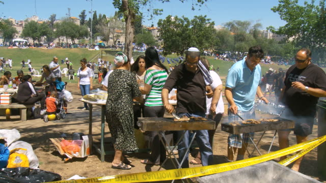MS Shot of local people having picnik and barbecue grill on independence day celebration at Sacker park / Jerusalem, Judea, Israel