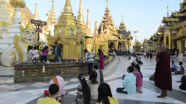 WS Shot of local people pouring water on Buddha likeness at shrine in shwedagon pagoda / Yangon, Yangon Division, Myanmar