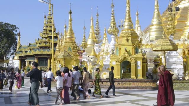 MS Shot of Local people walking around famous Shwedagon Pagoda / Yangon, Yangon Division, Myanmar