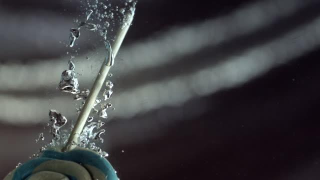 cu slo mo shot of lollipop falling into water / seoul, south korea - lollipop stock videos and b-roll footage