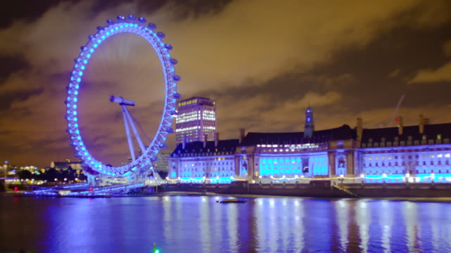 ms t/l shot of london eye at evening / london, united kingdom - millennium wheel stock videos & royalty-free footage