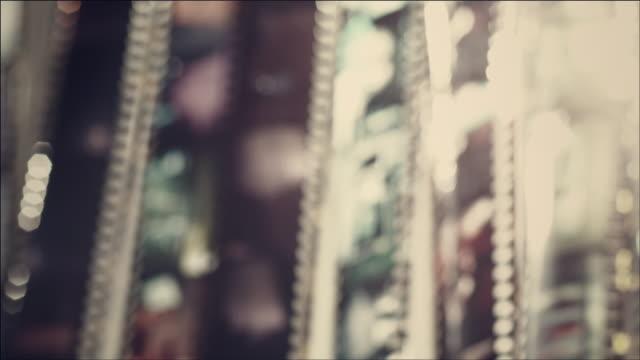 shot of looking through film with light - 写真フィルム点の映像素材/bロール