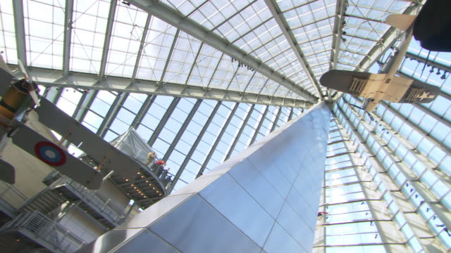 ws pan shot of looking up stainless steel spire and  aircraft suspended over the leatherneck gallery at the entrance of national museum of the marine corps / triangle, virginia, united states - us airforce stock videos & royalty-free footage