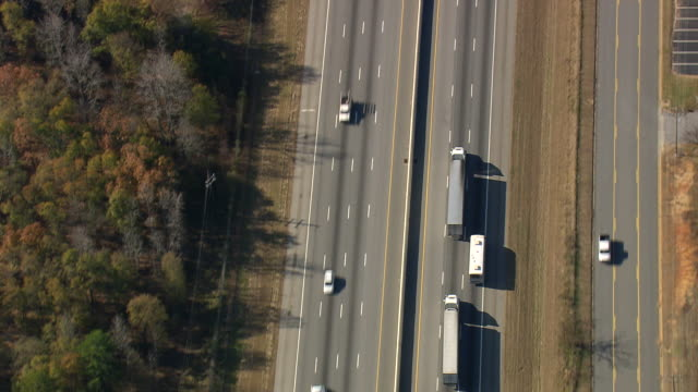 ms aerial ts shot of lorry on highway / south carolina, united states - articulated lorry stock videos & royalty-free footage