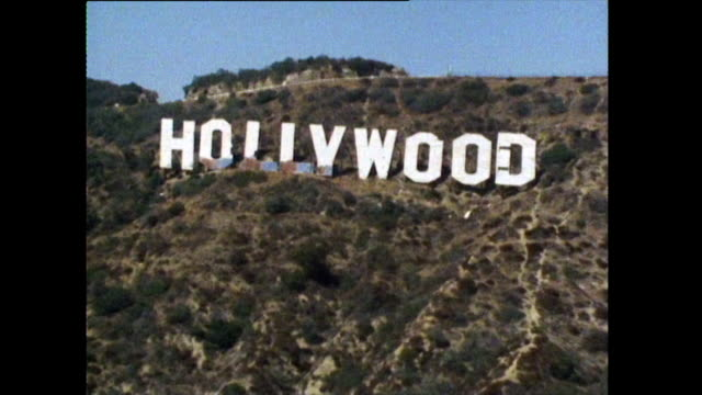 shot of los angeles beach and hollywood sign; 1972 - hollywood los angeles video stock e b–roll