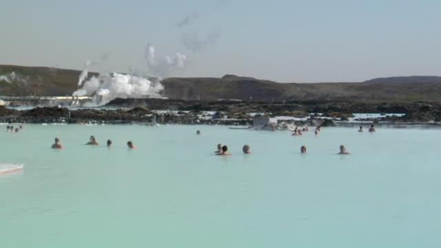 ms shot of lots of people relax in hot spring / reykjavik, hofudhborgarsvaedhi, iceland - wiese stock videos & royalty-free footage