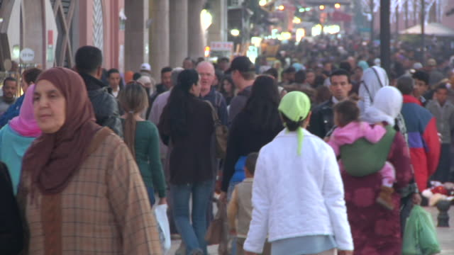 ms shot of lots of people walking on street / marrakech, tensift, morocco  - north africa stock videos & royalty-free footage