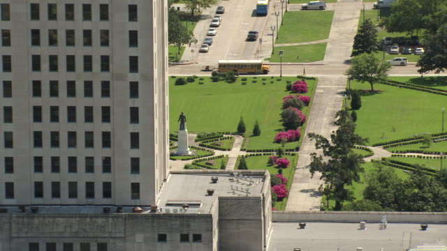 MS AERIAL Shot of louisiana state capitol building with gardens / Baton Rouge, Louisiana, United States