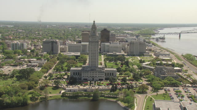 ws aerial ts shot of louisiana state capitol building with mississippi river / baton rouge, louisiana, united states - baton rouge stock-videos und b-roll-filmmaterial