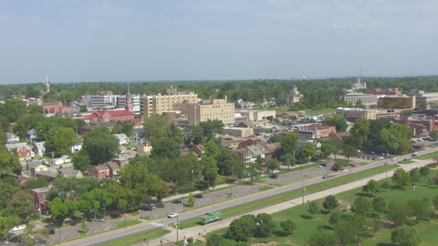 MS AERIAL TU Shot of low fly over Missouri River to reveal Historic District / St Charles, Missouri, United States