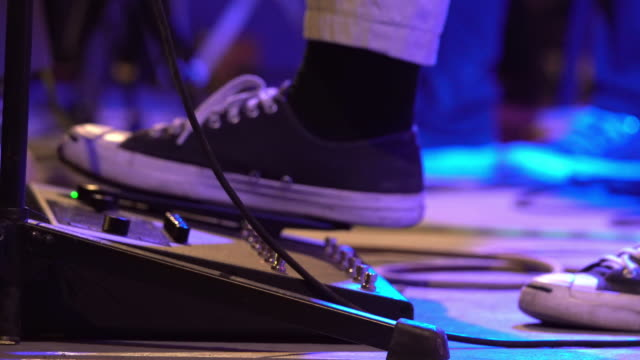 shot of low section musician on the stage pushing on guitar effect pedal - amplifier stock videos & royalty-free footage