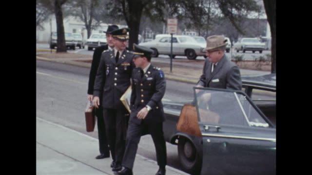 shot of lt william calley arriving at fort benning's courthouse for a hearing into the my lai massacre. - mass murder stock videos & royalty-free footage
