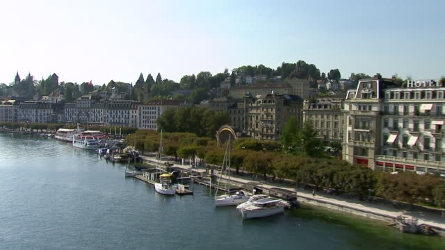 ms aerial shot of lucerne and lake lucerne with musegg wall and court church of st. leodegar and townscape and lake promenade / lucerne, switzerland - lake lucerne stock videos & royalty-free footage