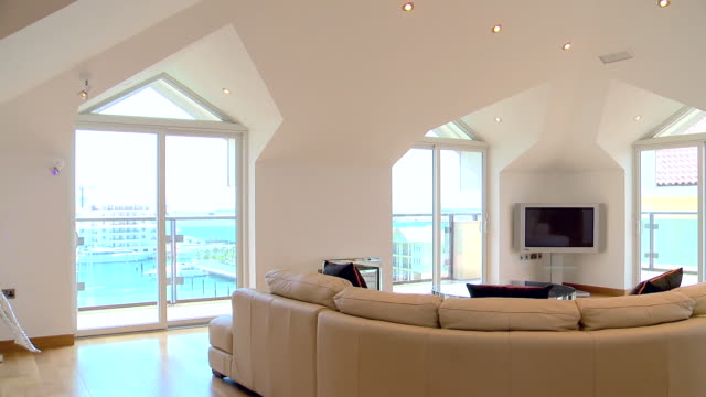 ws pan  shot of luxury penthouse interior / gibraltar - penthouse stock videos and b-roll footage