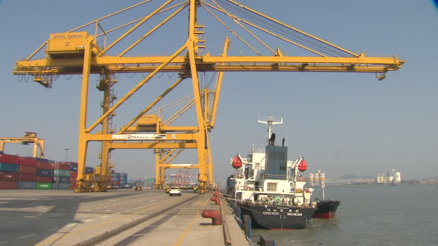 shot of machine taking up container at incheon commercial dock - picking up stock videos & royalty-free footage