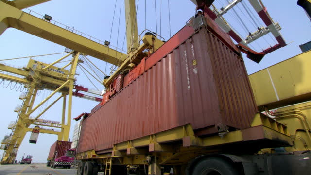 MS CU TS Shot of Machine taking up container from truck atIncheon Commercial dock / Incheon, South Korea