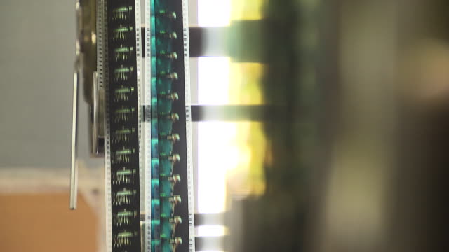 shot of machine working at film projection room - film projector stock videos & royalty-free footage