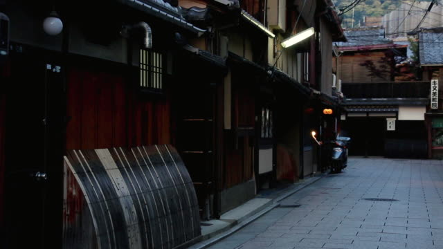 MS Shot of machiya townhouses in Hanamikoji Dori street at dusk and machiya are traditional wooden townhouses found throughout Japan / Gionmachi, Kyoto, Japan