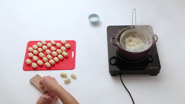 MS Shot of making dough and frying / Seoul, South Korea