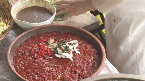 vídeos y material grabado en eventos de stock de shot of making kimchee seasoning - comida coreana