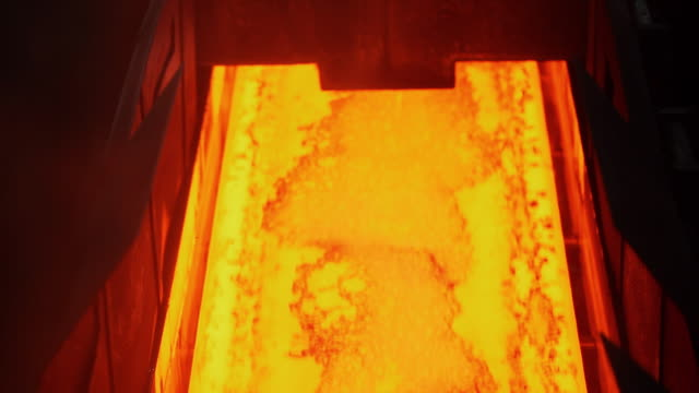 shot of making process steel in iron foundry plant - molten stock videos and b-roll footage