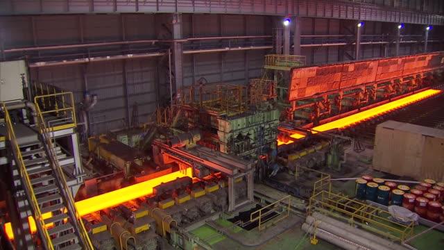 ms pan shot of making process steel, molten steel bar at end of production / gwangyang, jeollanamdo, south korea - steel stock videos & royalty-free footage