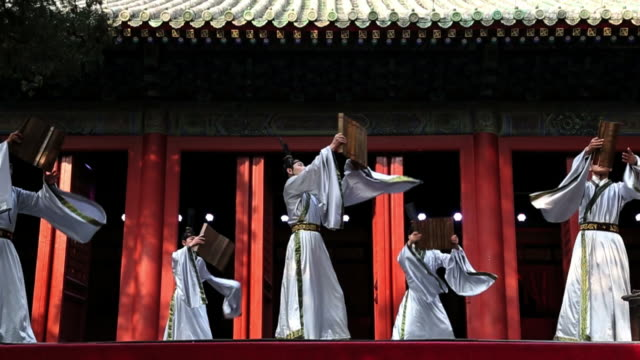WS SLO MO Shot of male dancers performing traditional costume AUDIO / Beijing, Hebei Province, China